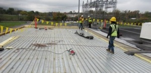 workers repairing a commercial flat roof