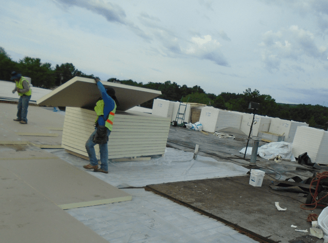 roofers at work on a commercial roof