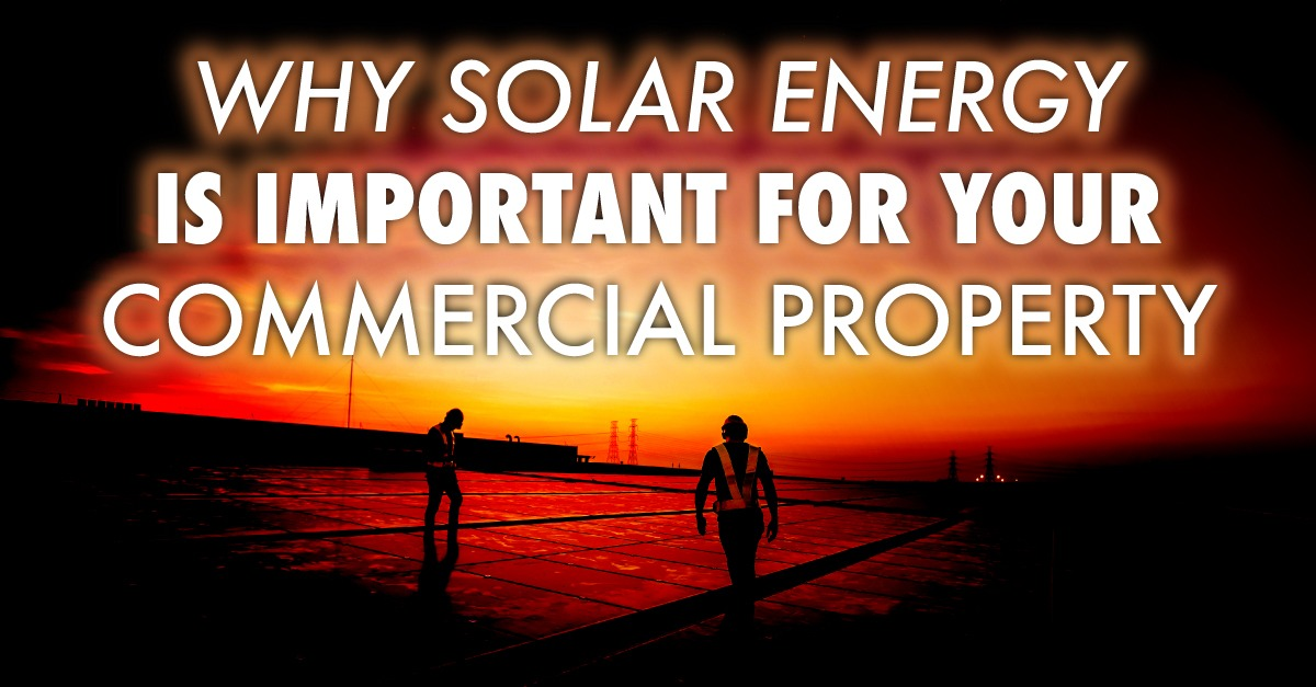 two people walking by solar panels with the caption Why Solar Energy Is Important For Your Commercial Property